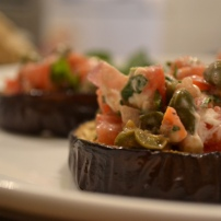 Roasted Eggplant with Tomatoes, Mint, and Goat Cheese
